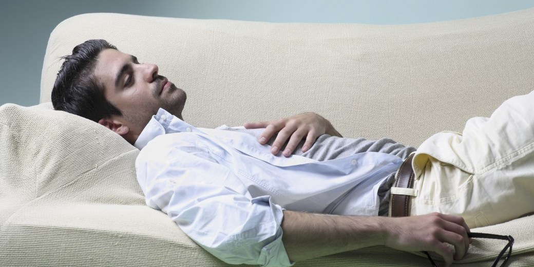 young man resting in a sofa _ Horizontal